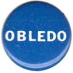 The most commonly worn Obledo button.